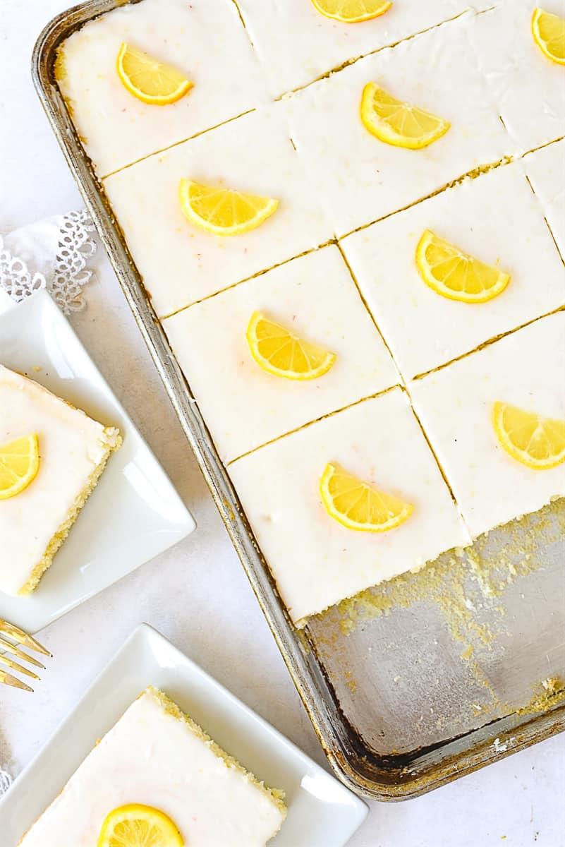 lemon sheet cake cut into pieces