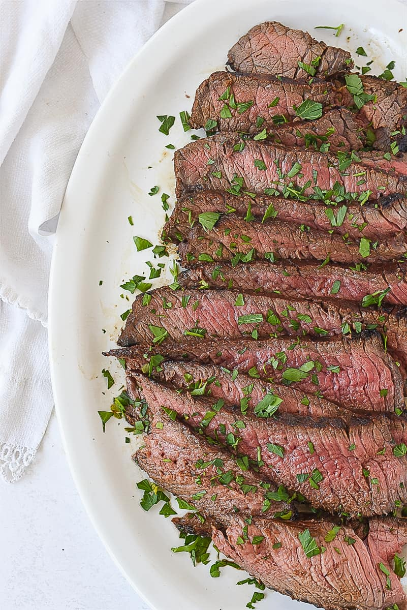 sliced london broil with parlsey on top
