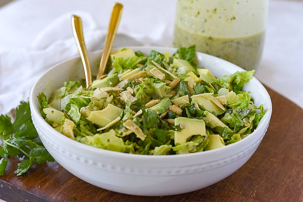 white bowl full of salad