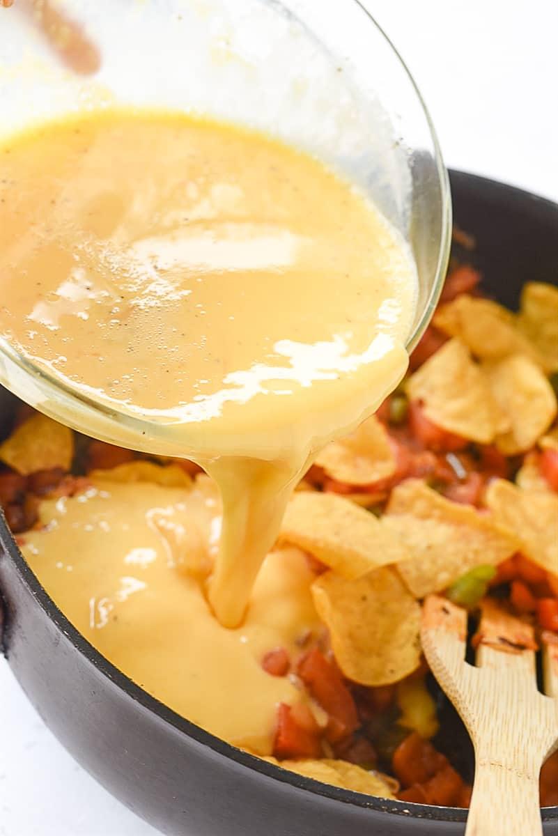 pouring eggs into migas pan