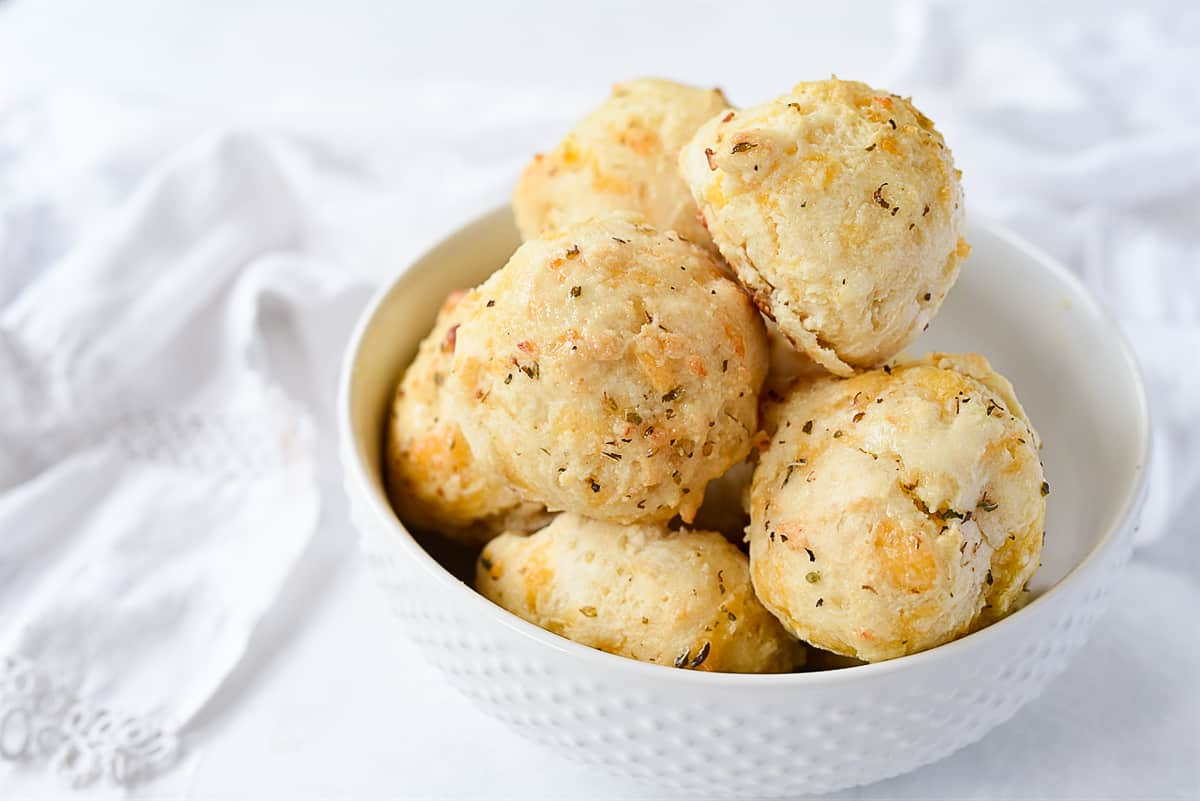 white bowl of biscuits