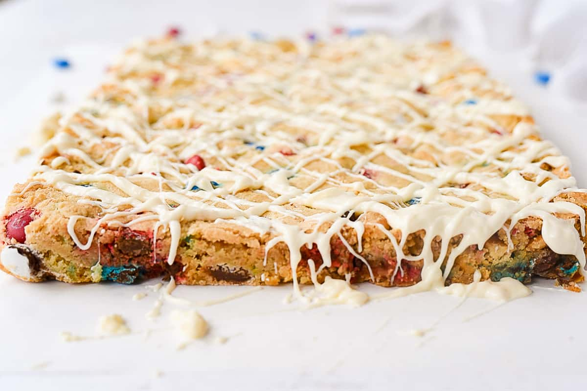 M &M Blondies drizzled with chocolate