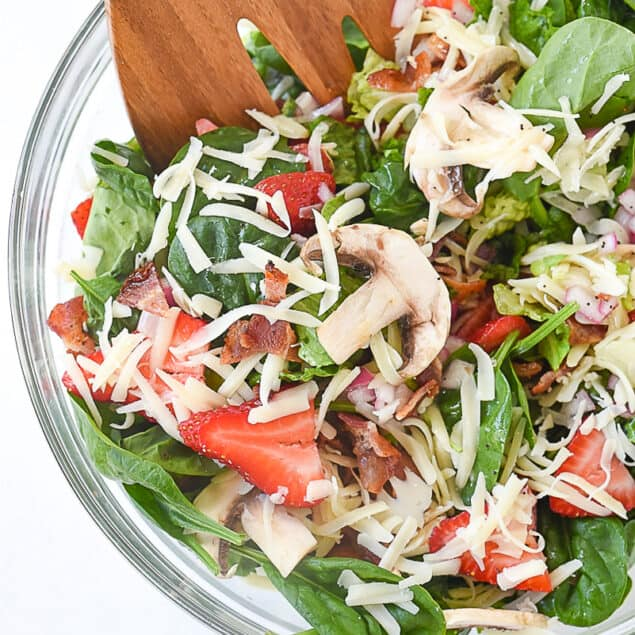 overhead shot of spinach salad in a bowl