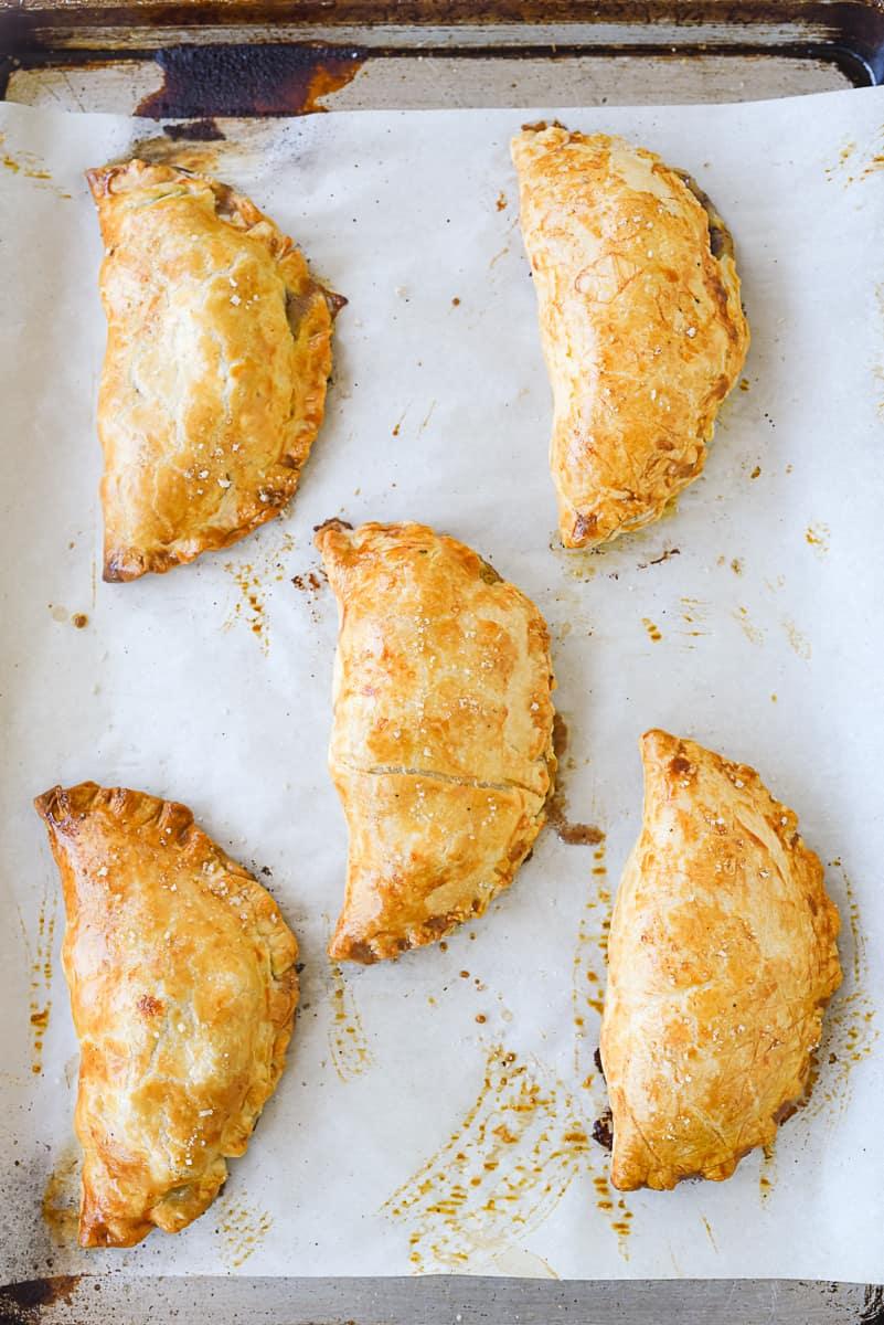 baked cornish pastry on baking sheet