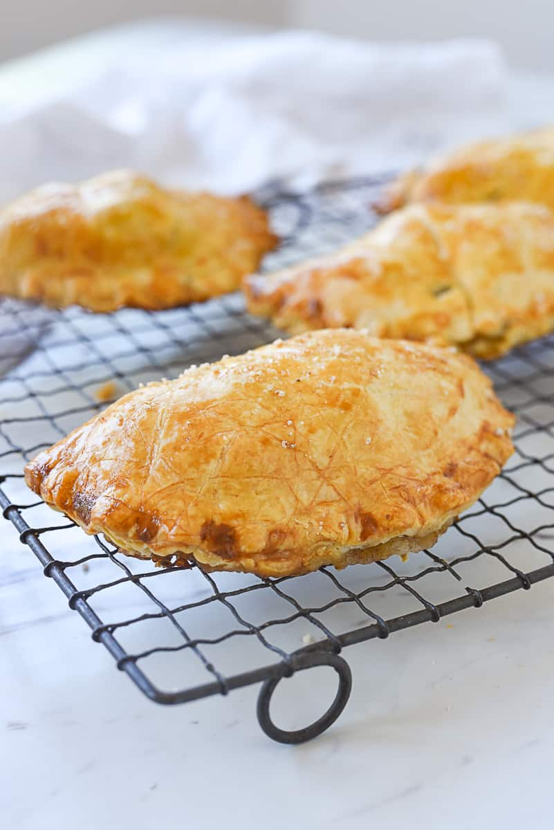 CORNISH pastry on a cooling rack