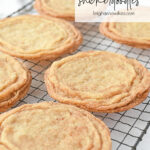 crispy snickerdoodle cookies on a cooling rack