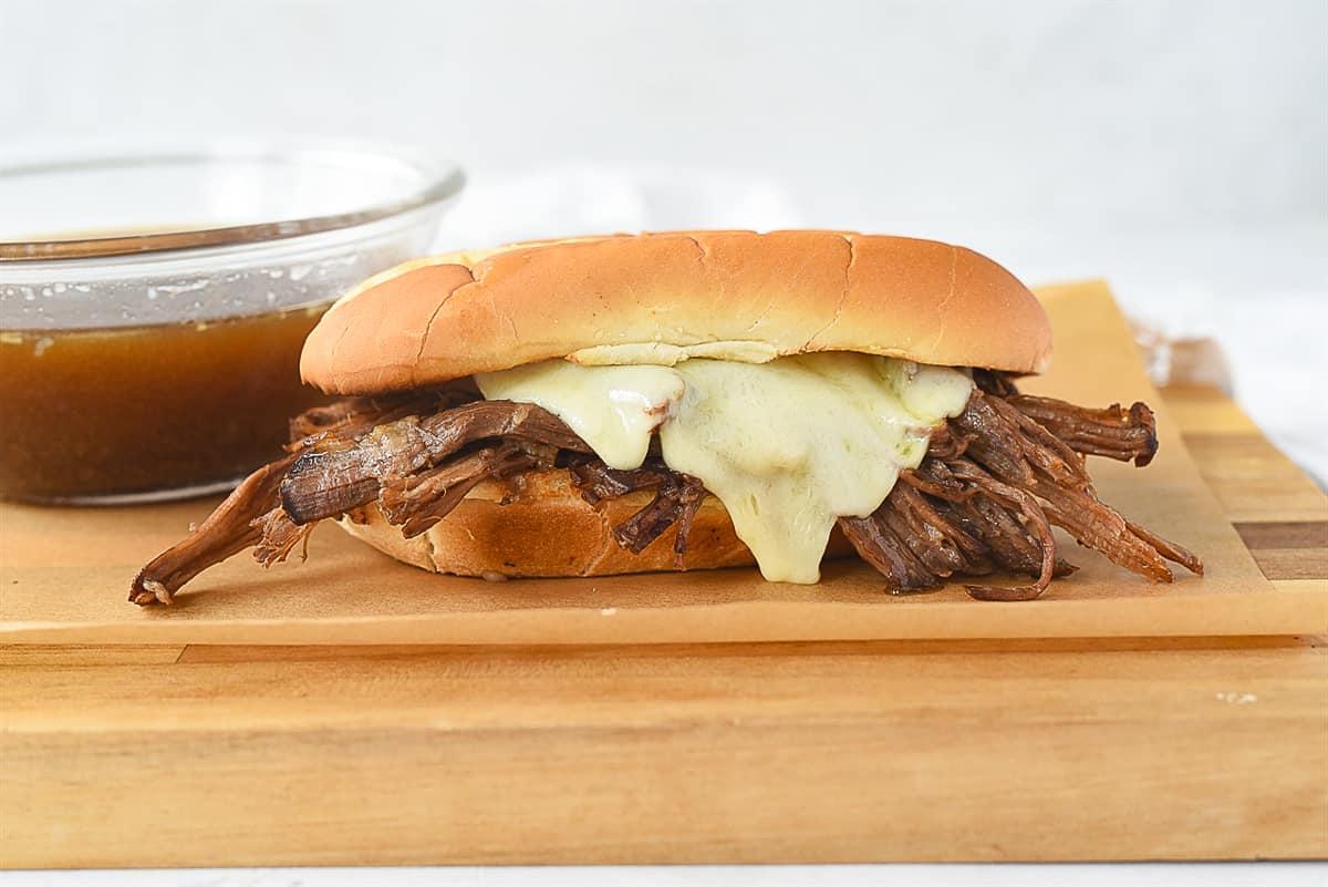 tri tip sandwich on a board