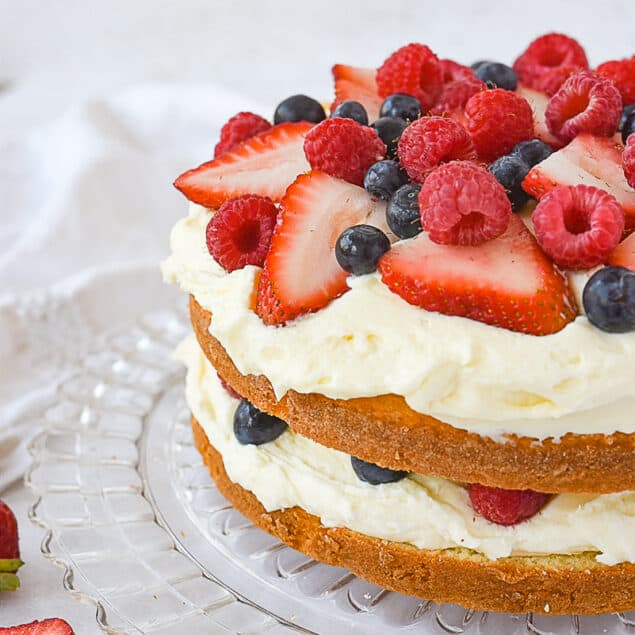 Lemon berry cake with fresh berries on top