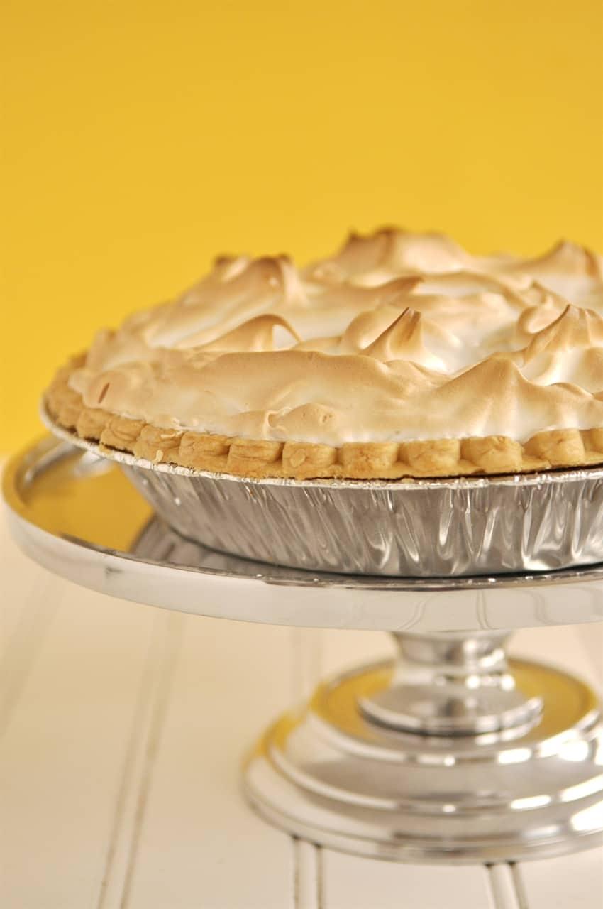lemon meringue pie on a cake stand