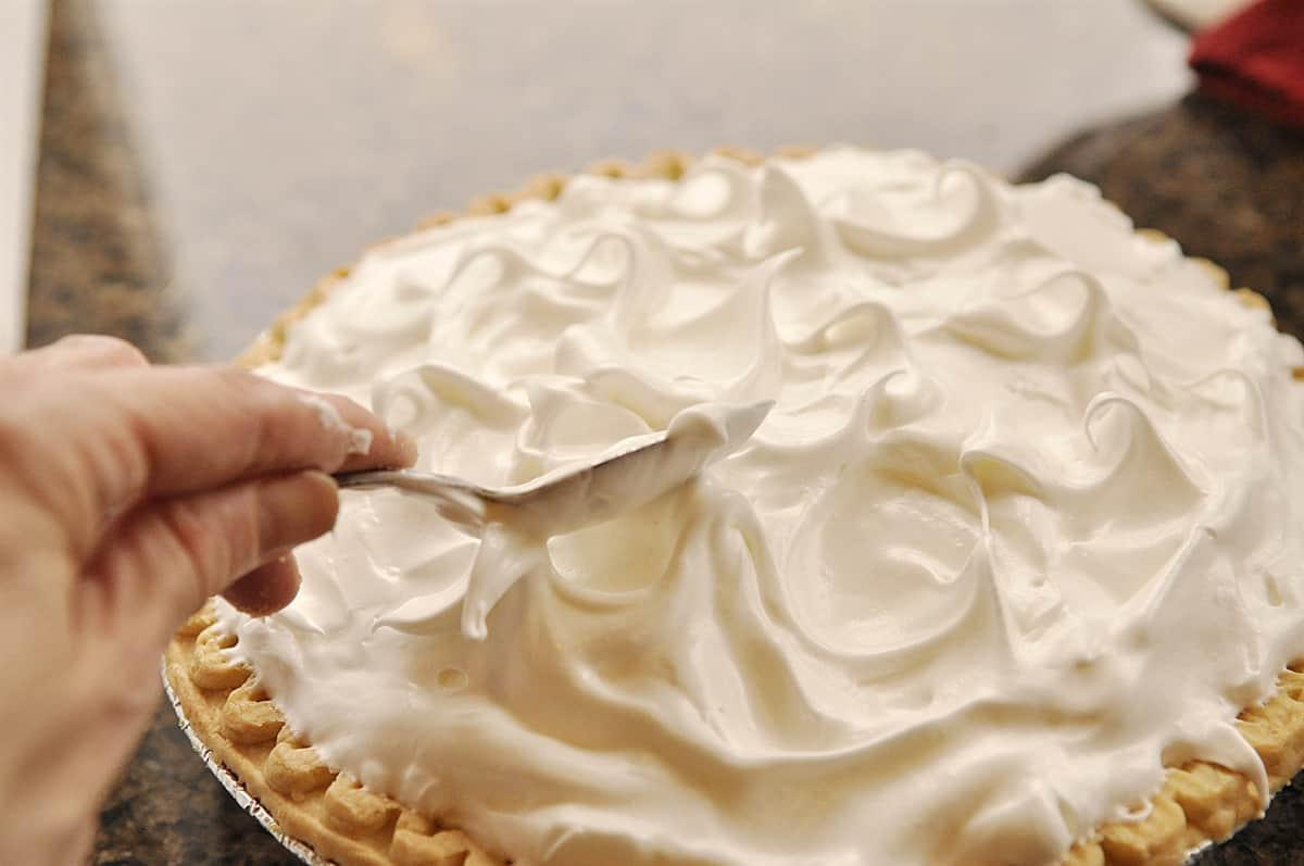 smoothing meringue on a pie