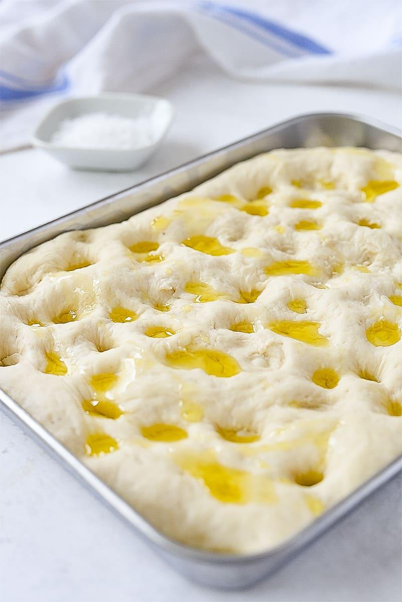 focaccia bread drizzled with oil
