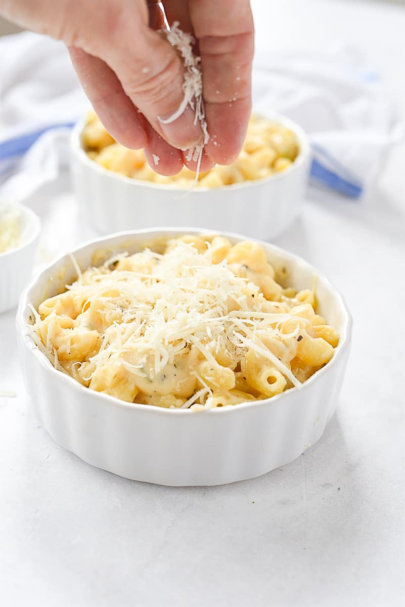 Sprinkling cheese on mac and cheese