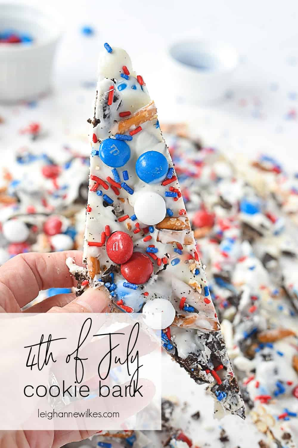 piece of 4th of july cookie bark in a hand
