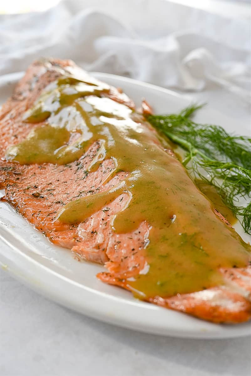 marinated salmon with sauce on top