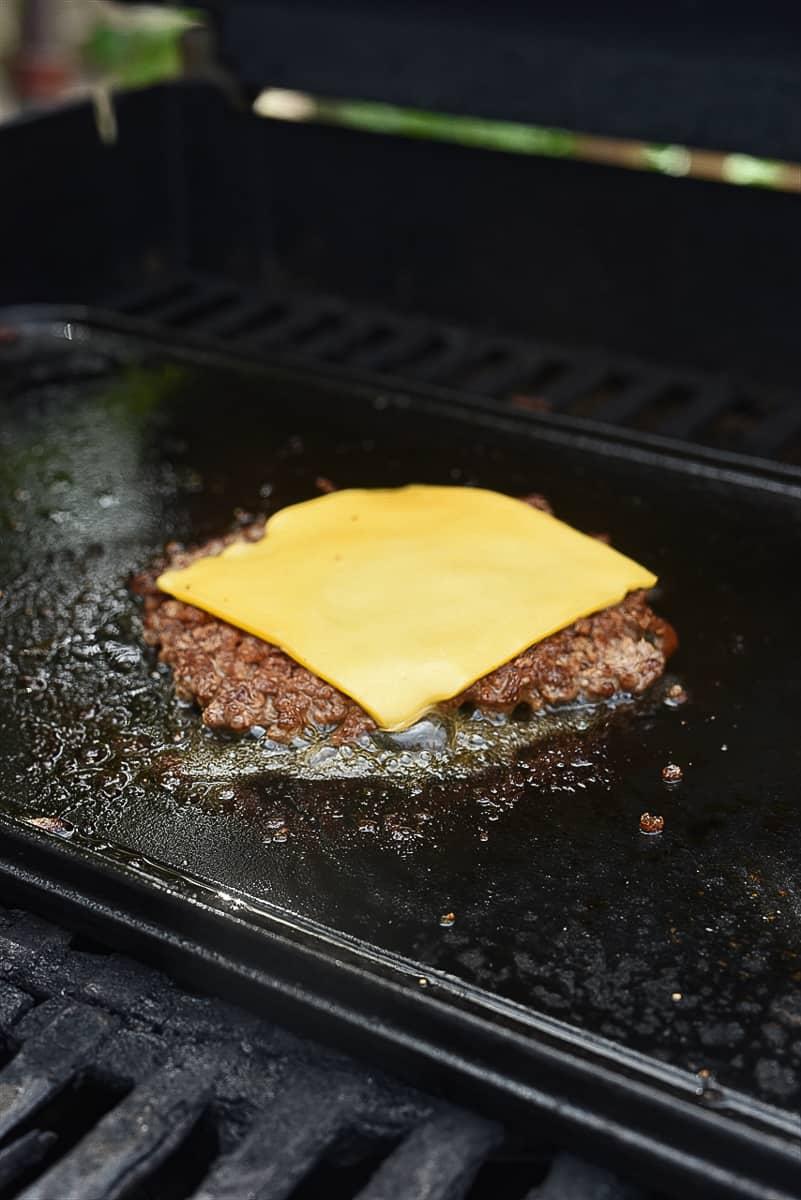 cheese melting on smash burger