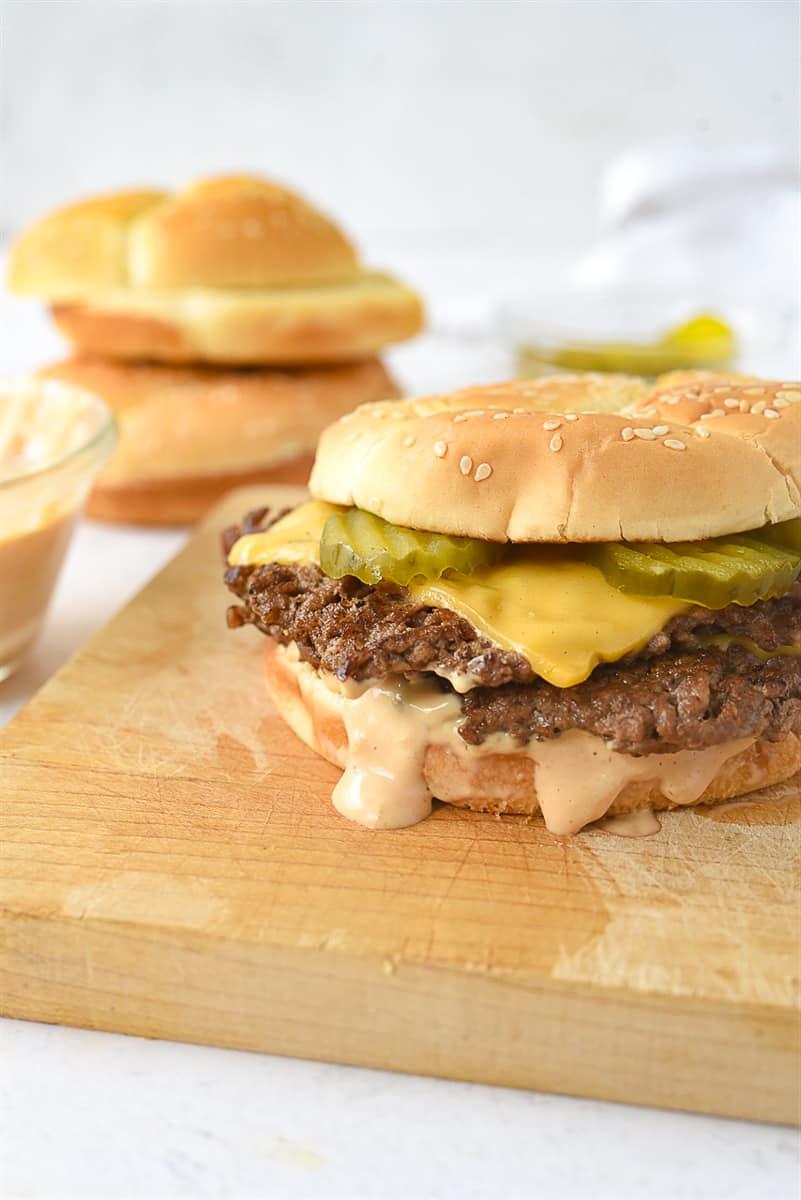 smash burger on a cutting board