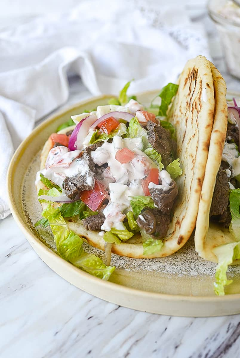 beef gyro with sauce on it