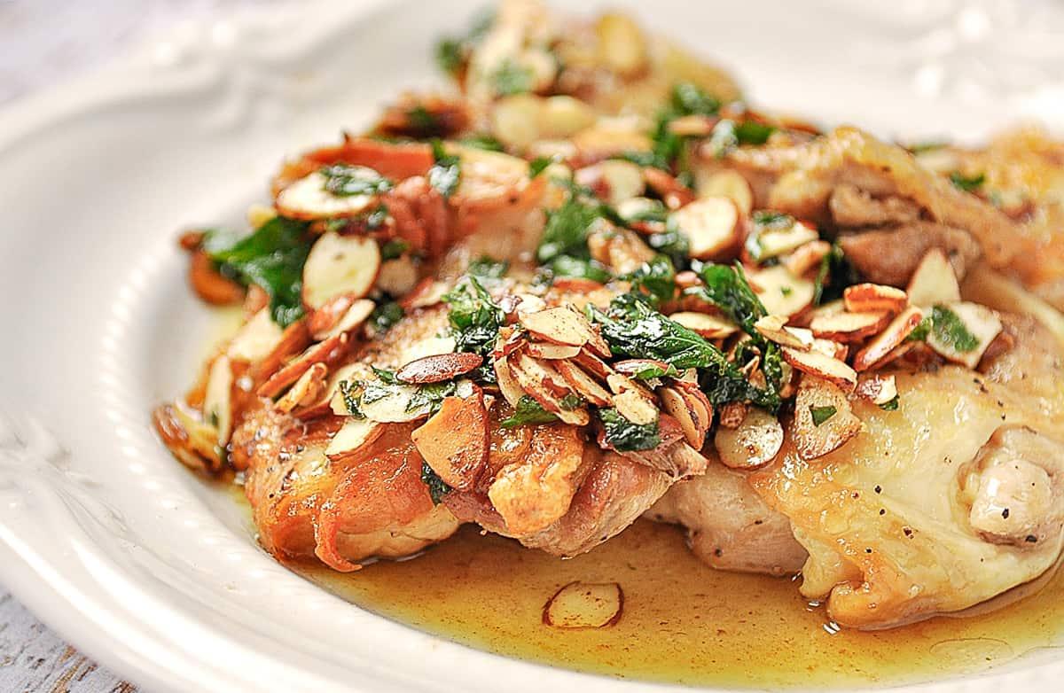 chicken amandine on a plate.