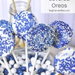 blue and white chocolate covered oreos on sticks