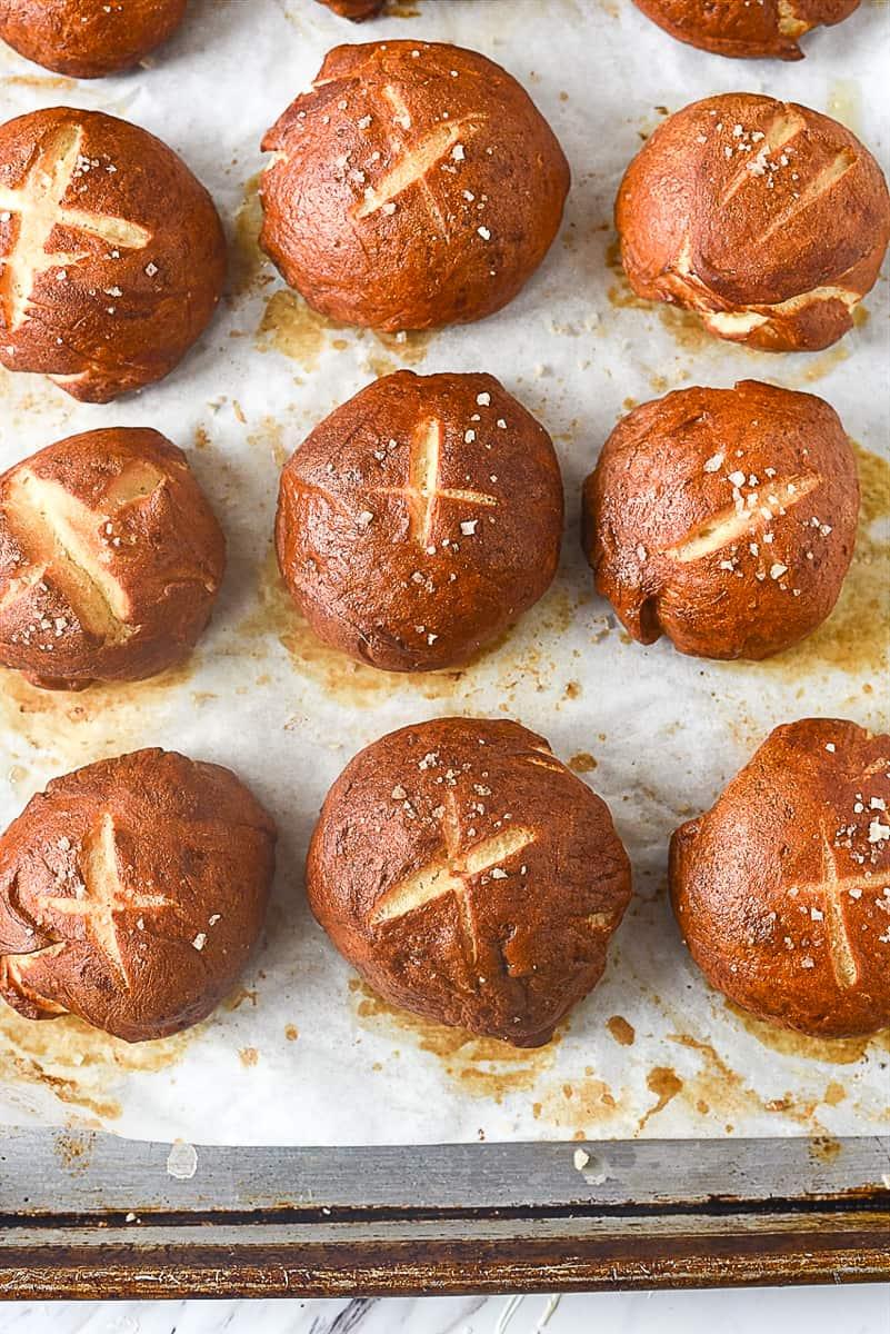 baked pretzel rolls on baking sheet