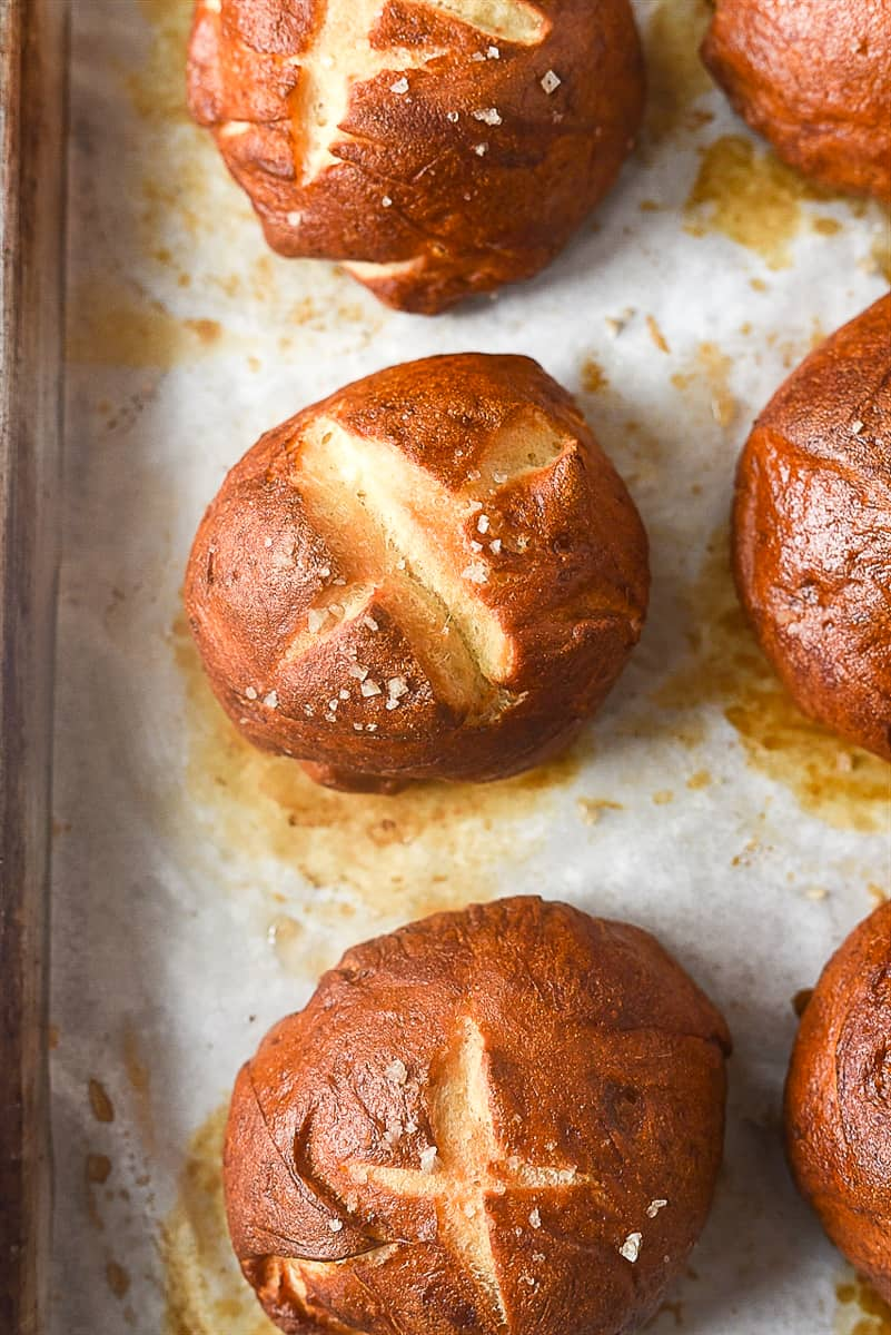 pretzel rolls on a baking sheet