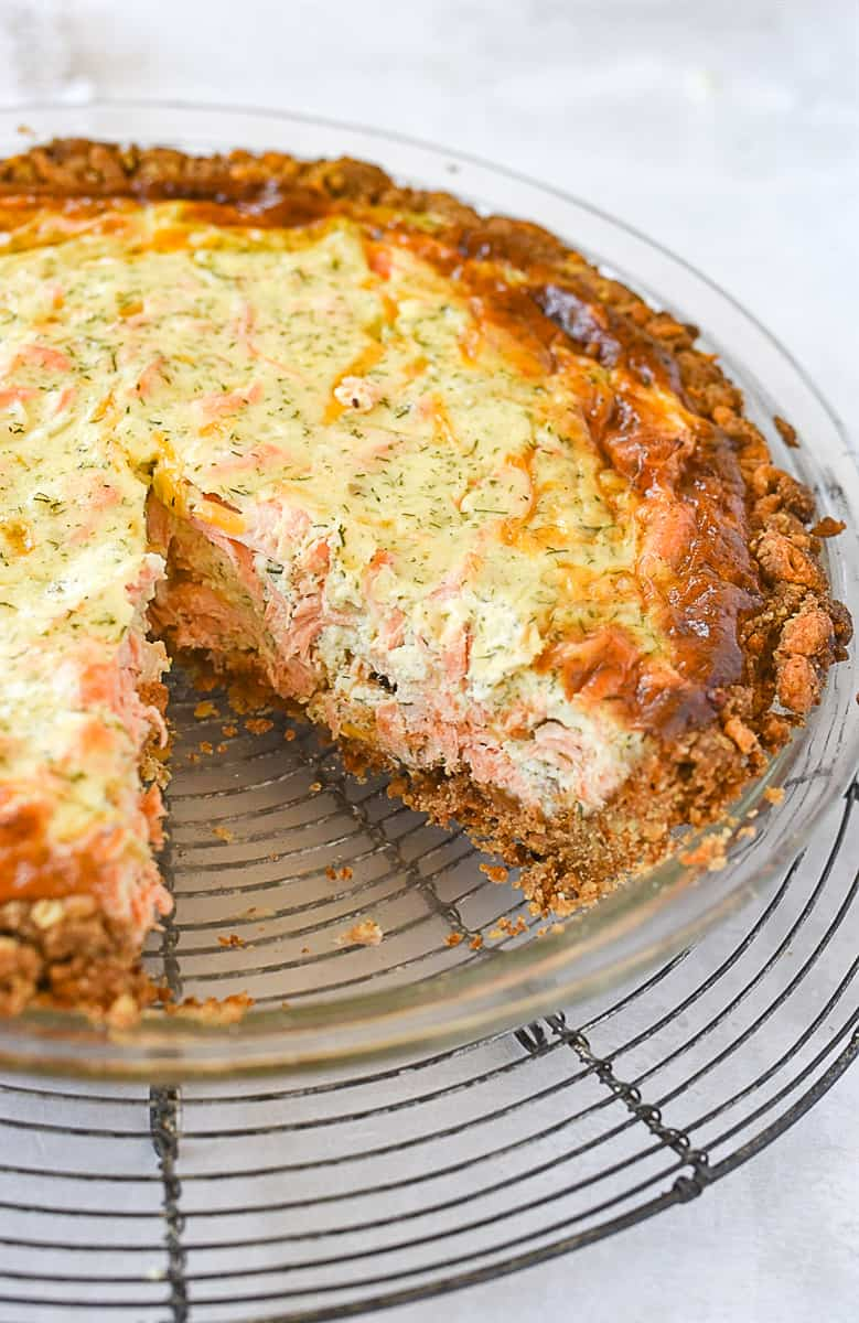 slice of salmon quiche out of dish