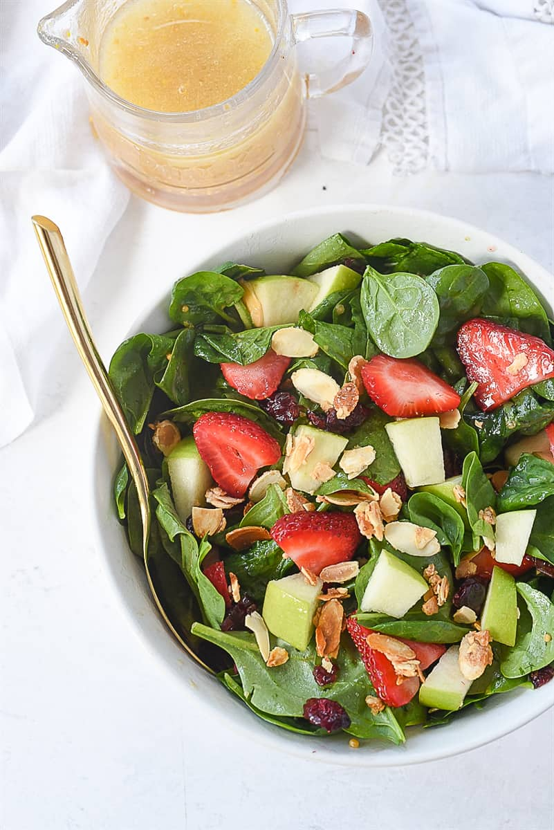 overhead shot of spinach fruit salad