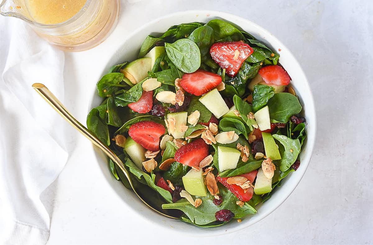 overhead of spinach fruit salad