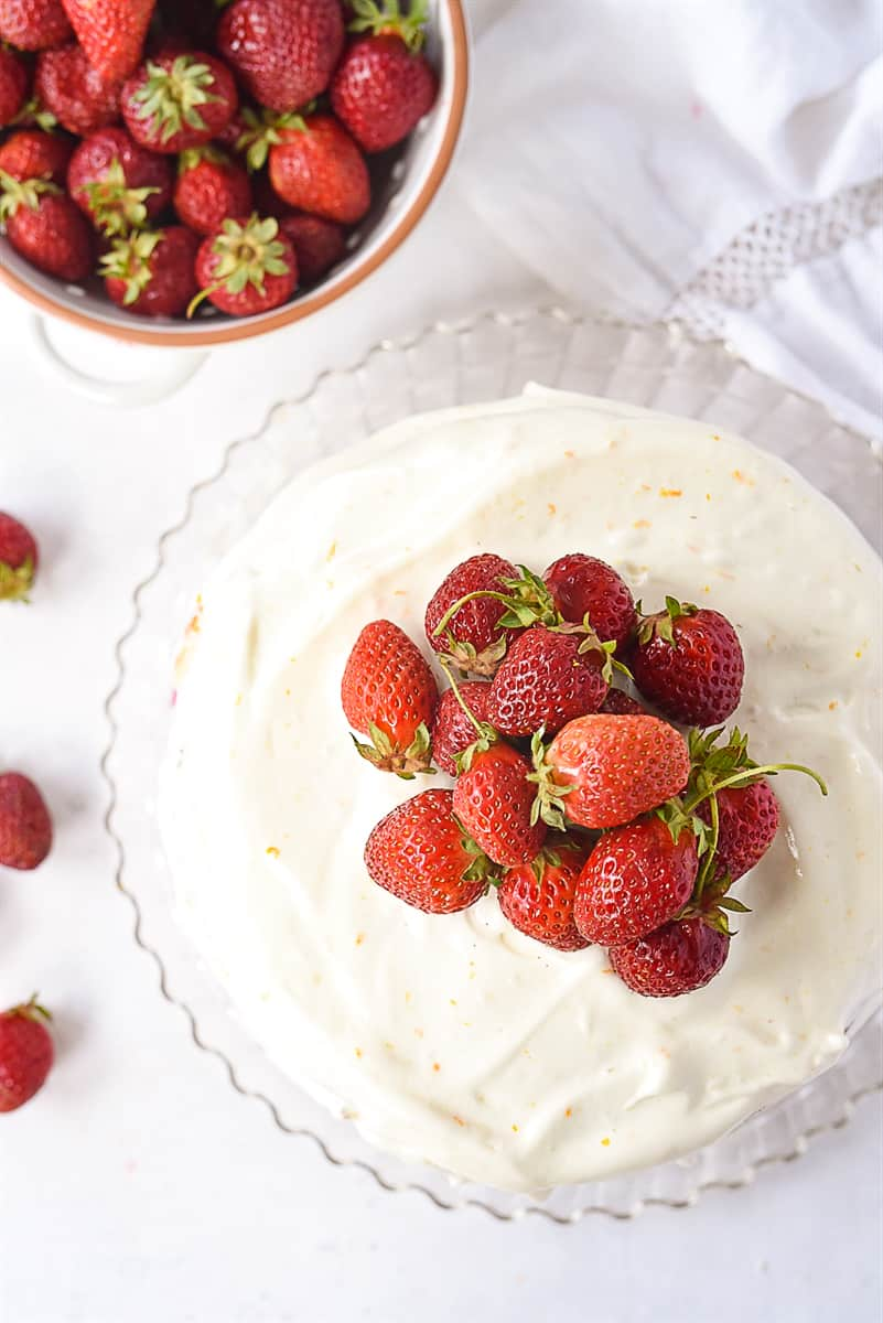 overhead shot of strawberry layer cake with strawberries on top
