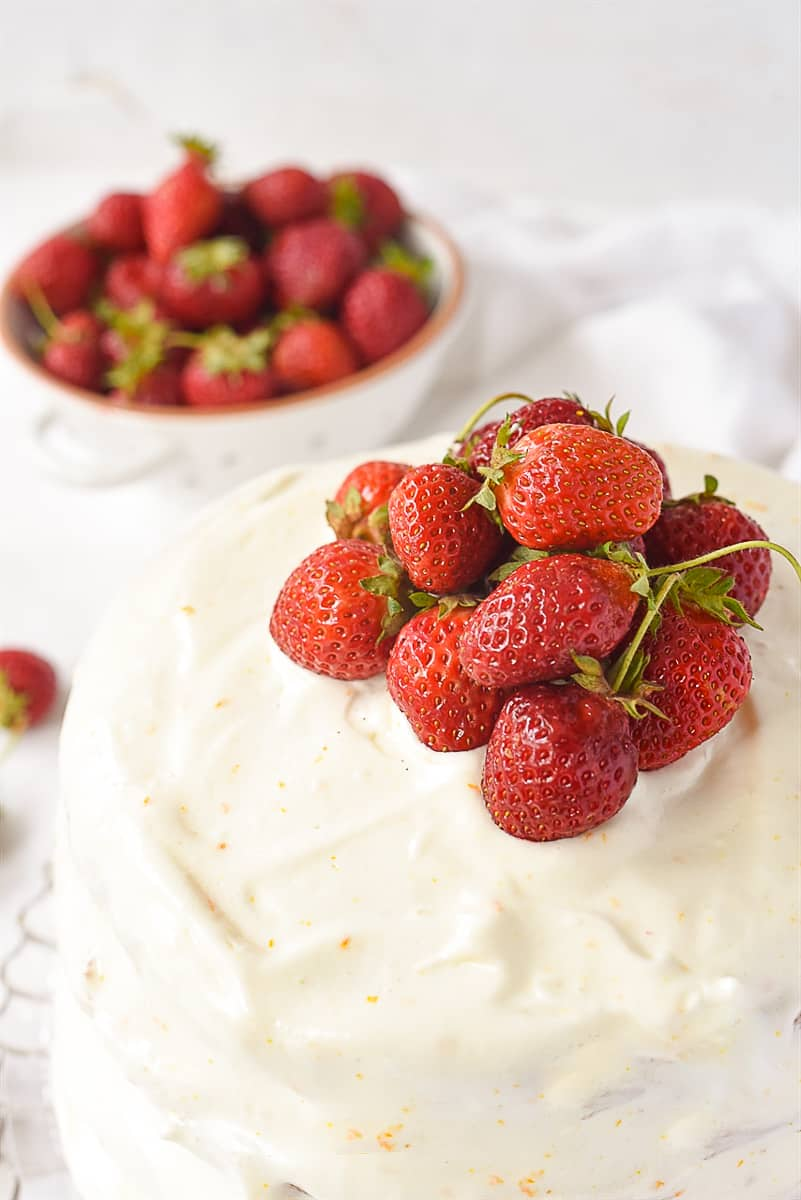 strawberries on top of layer cake