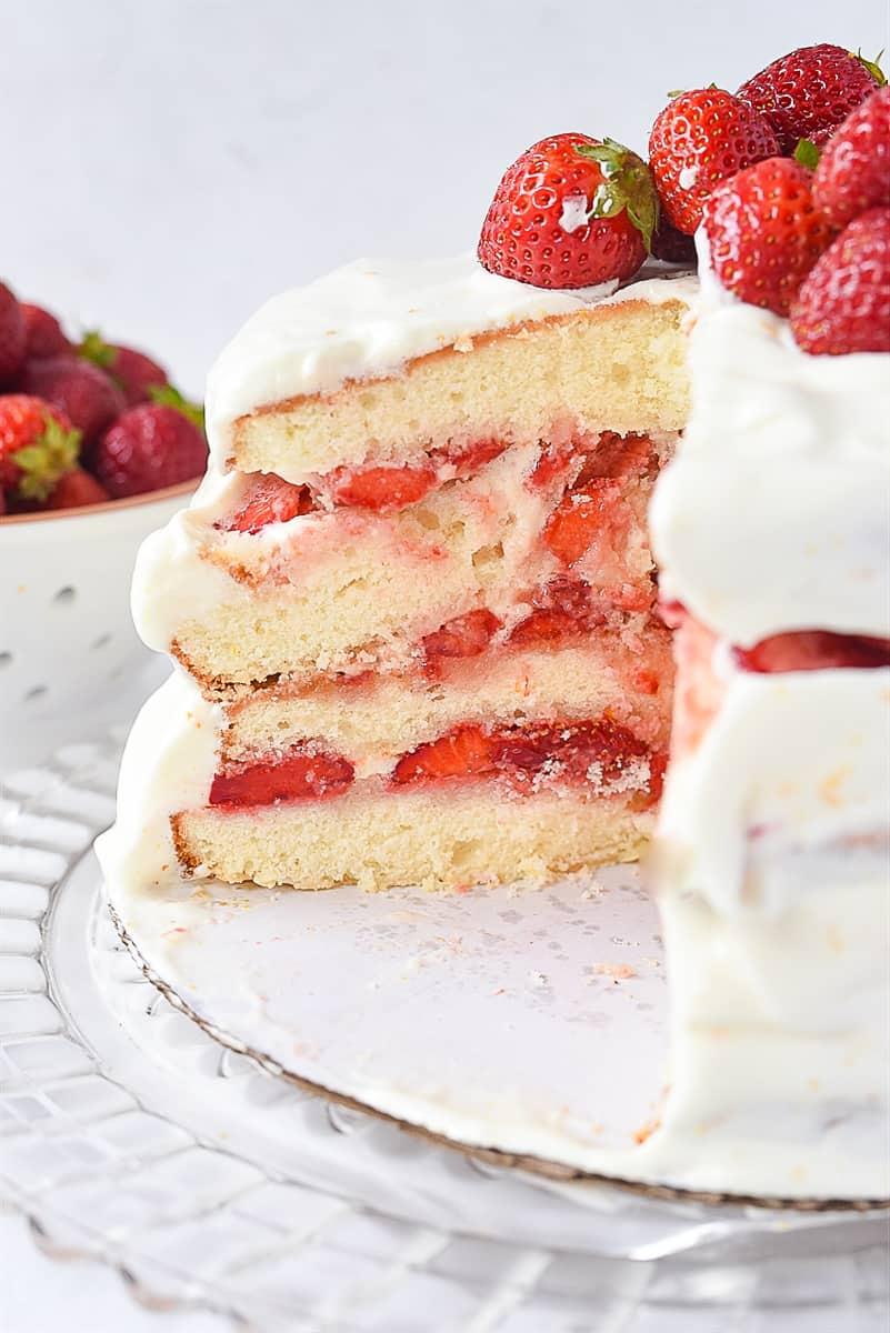 sliced strawberry layer cake
