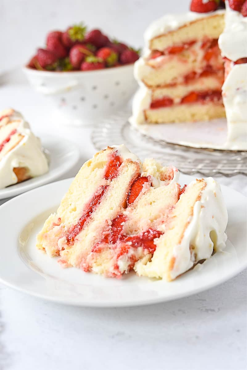 piece of strawberry layer cake on plate