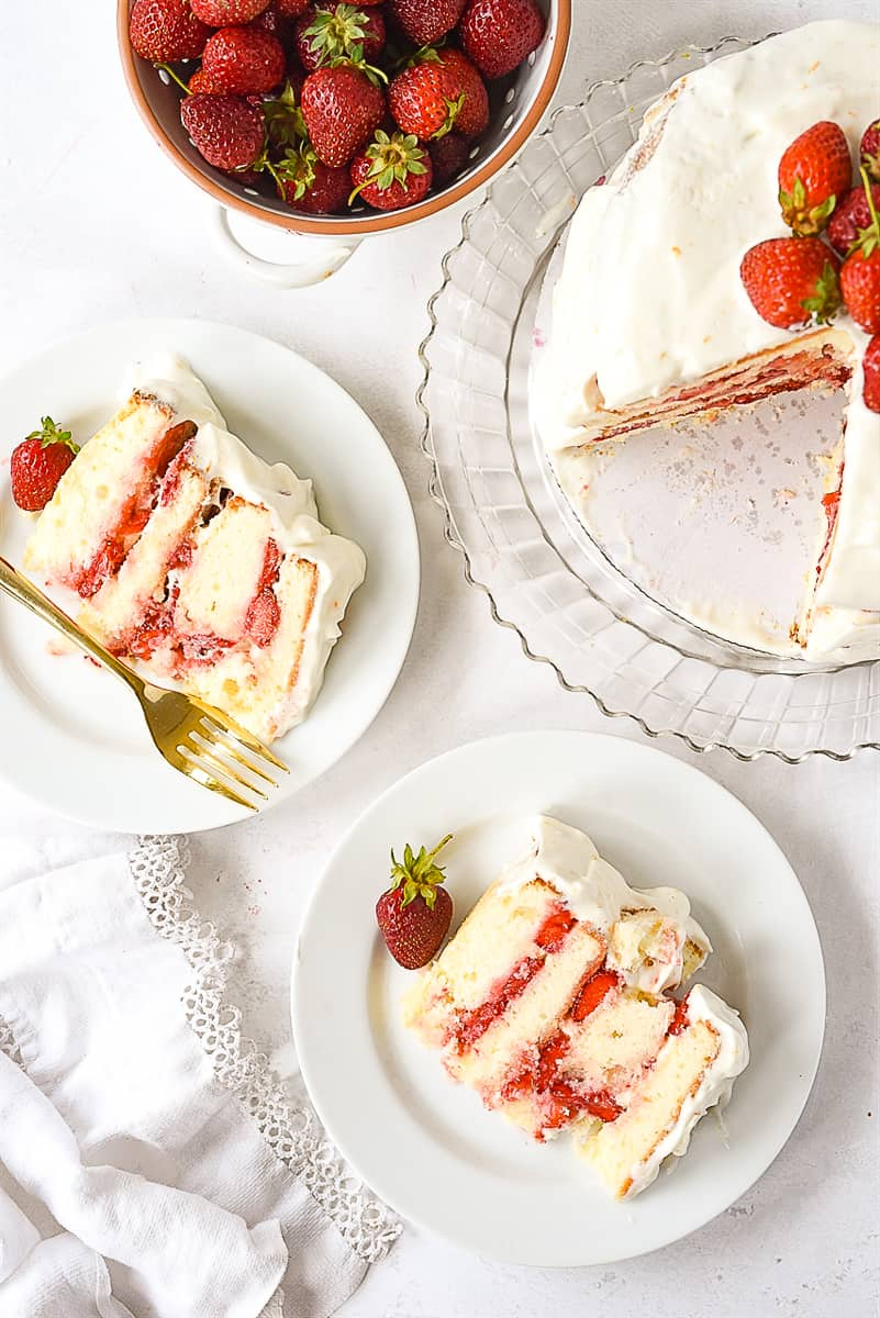 two slices of cake on plates.