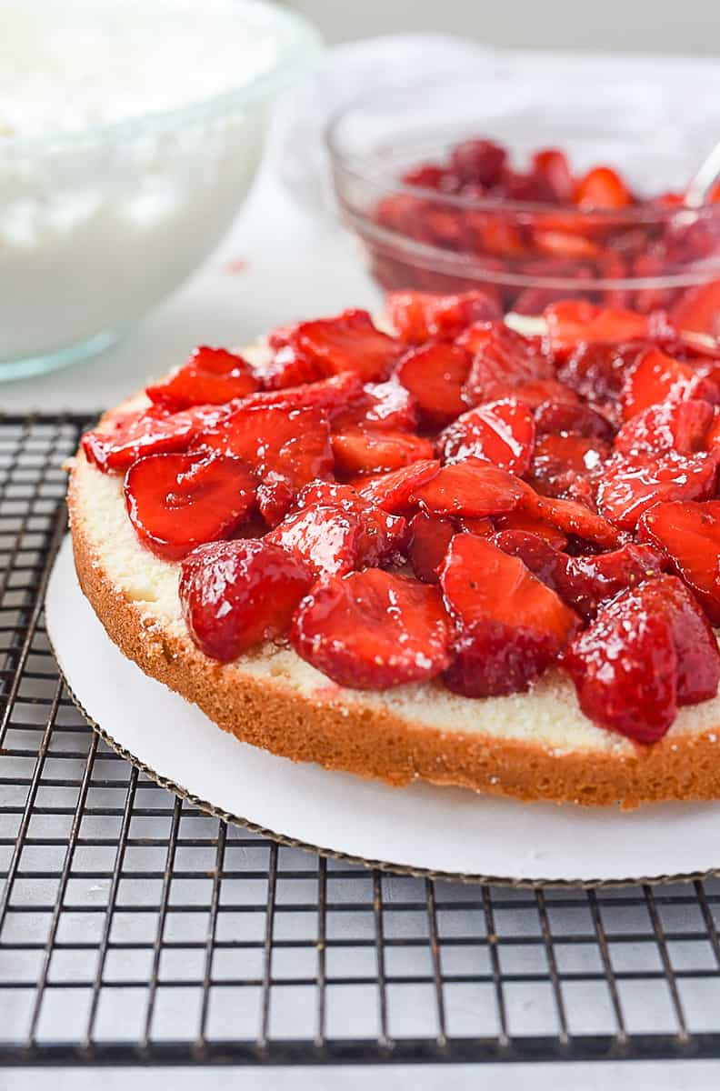 strawberries on top of cake layer