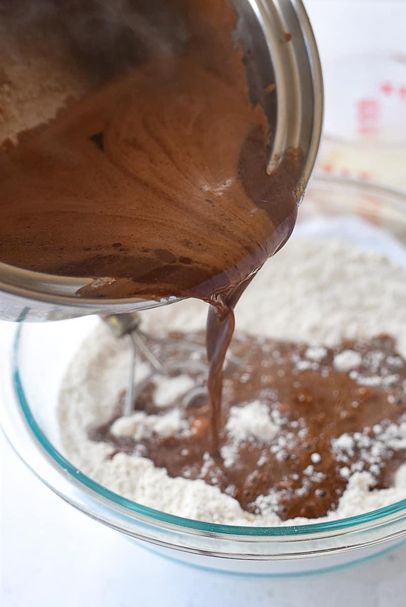 pouring chocolate mixture into flour