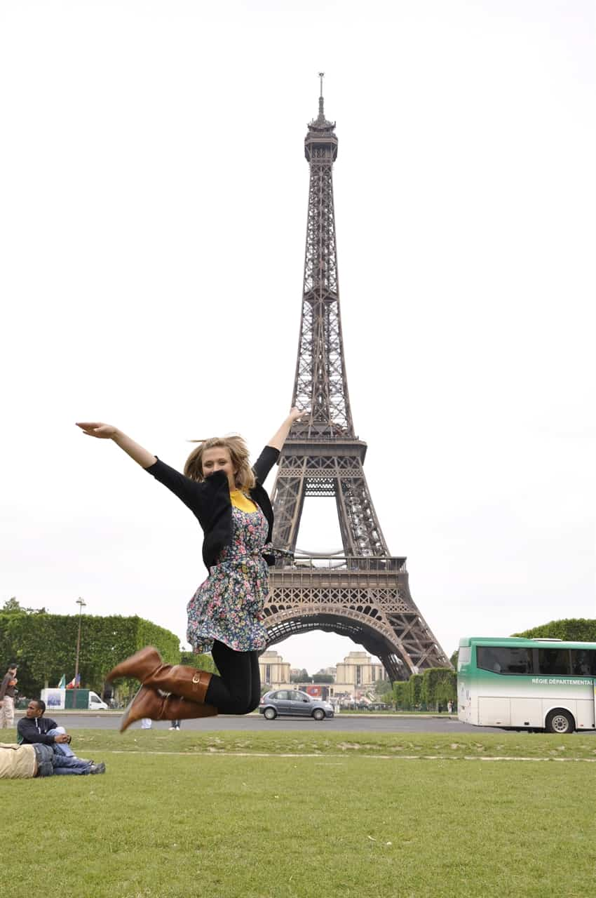jumping n front of eiffel tower