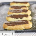 chocolate eclairs on a baking sheet