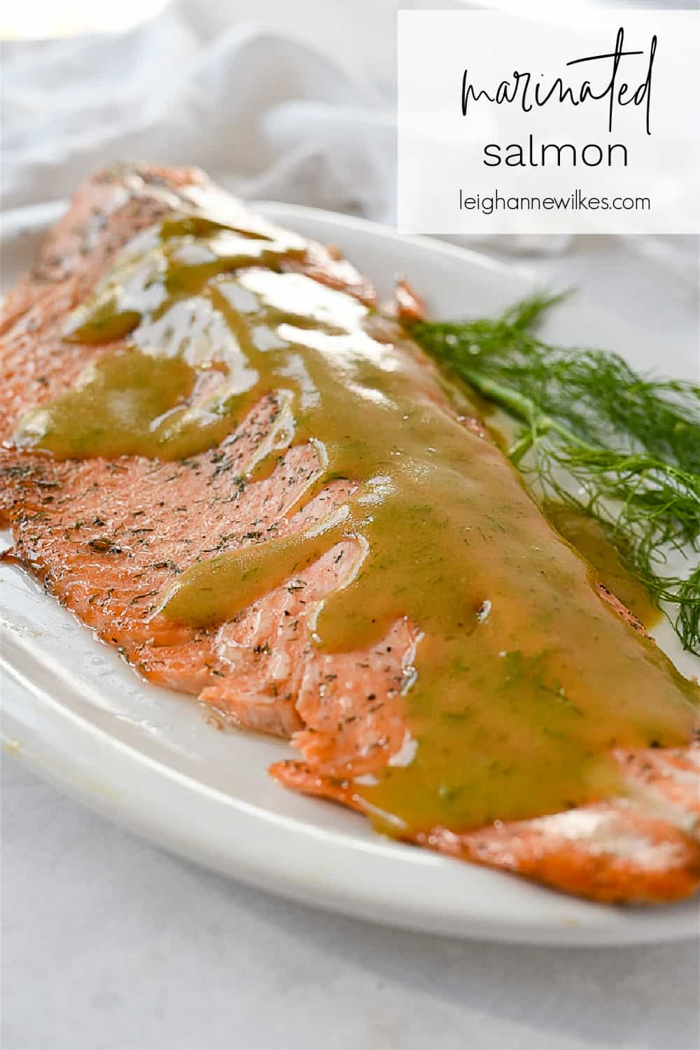 piece of marinated salmon with sauce on top