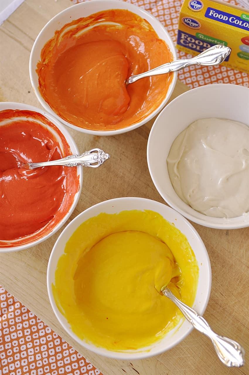 bowls of colored cake batter