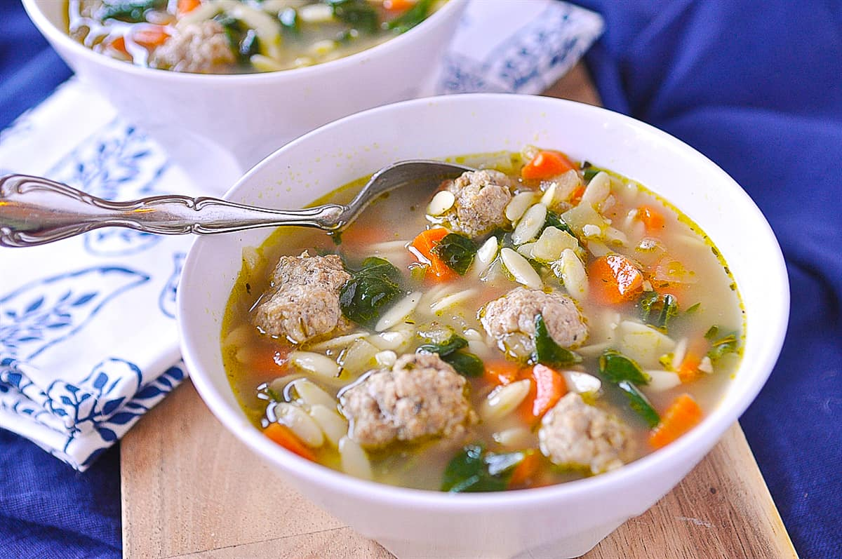 spoon in a bowl of italian wedding soup