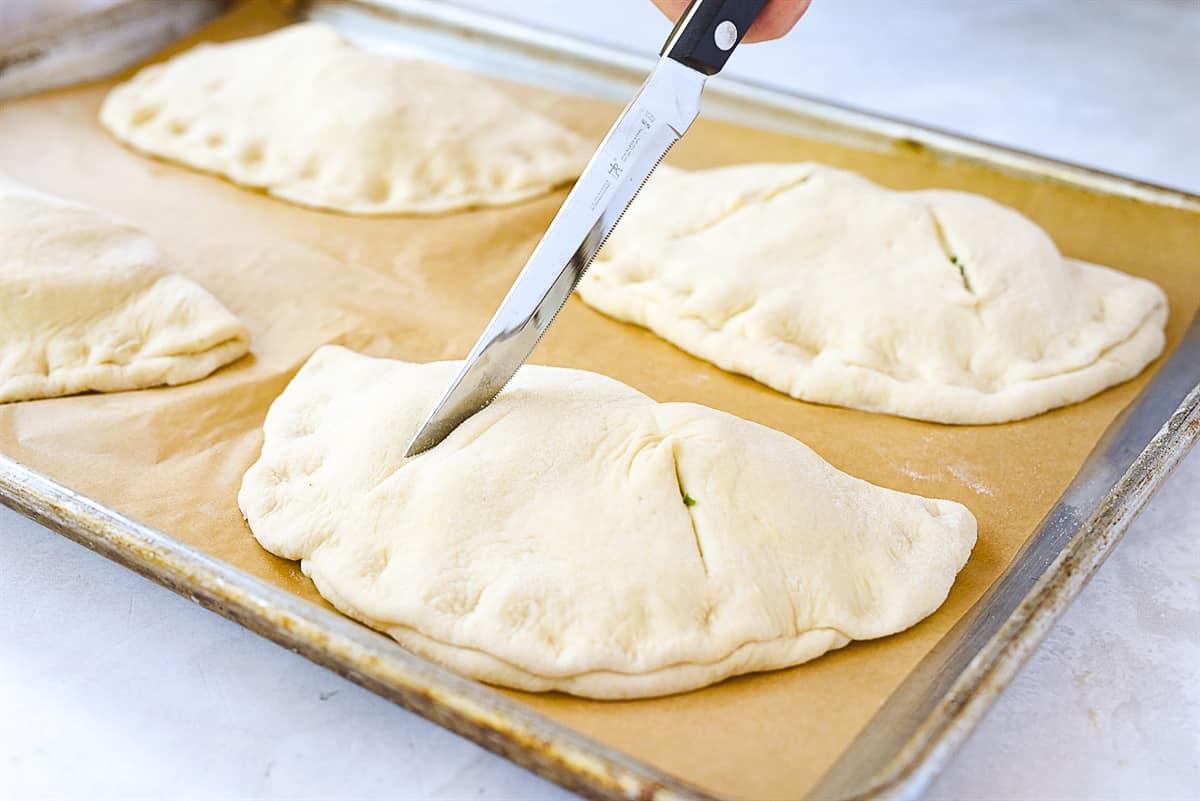 calzones on baking sheet