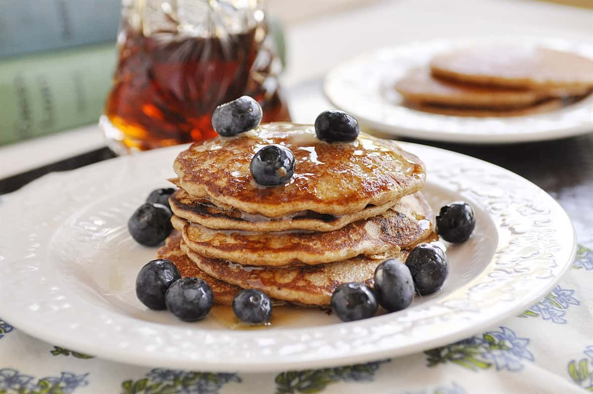 pile of pancakes with blueberries