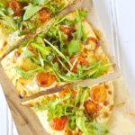 overhead shot of arugula pizza salad