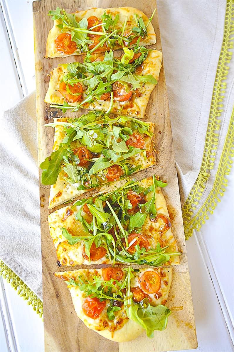 overhead shot of pizza arugula salad
