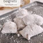 beignets on a baking sheet