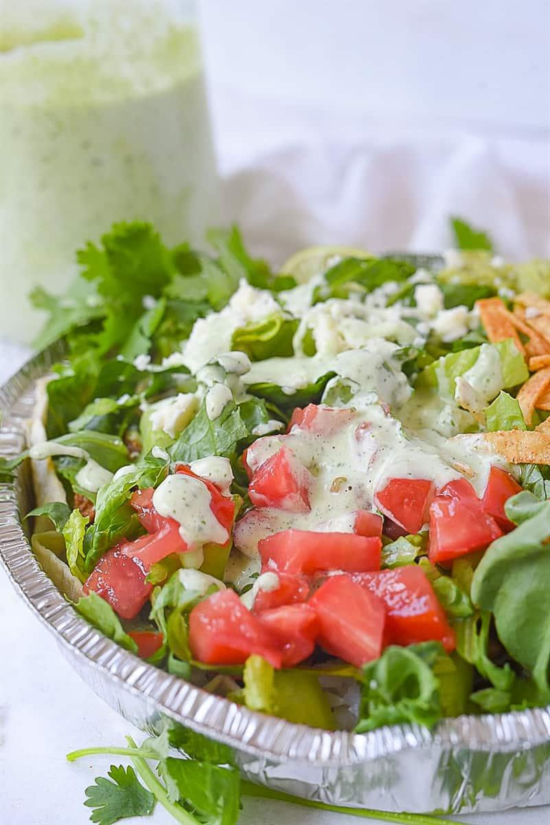 cafe rio salad in a metal tin