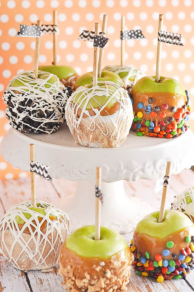 caramel apples on a cake plate