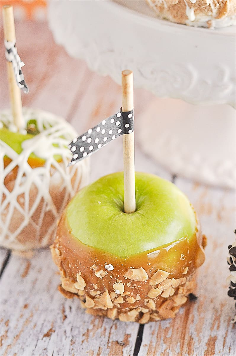caramel apple with  nuts on it