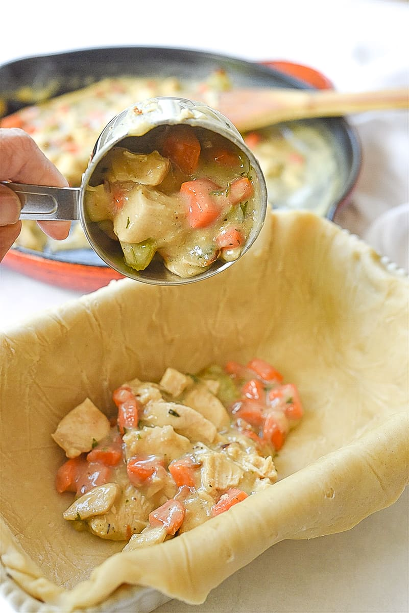 scooping chicken pot pie filing