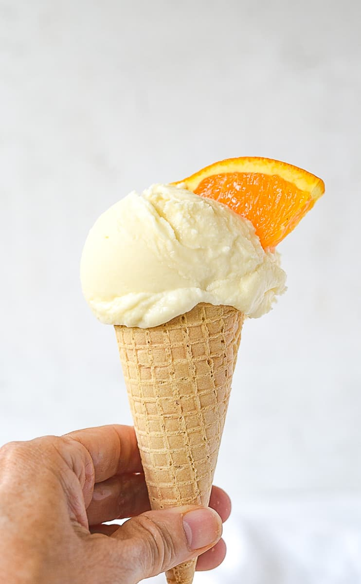 creamsicle ice cream in a hand